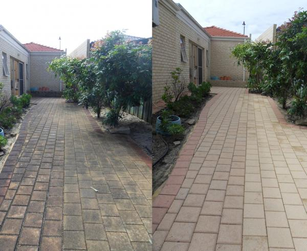 Brick building, pavement and walls cleaned with high pressure cleaning services